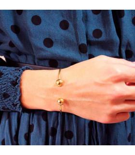 Open golden bracelet with two balls