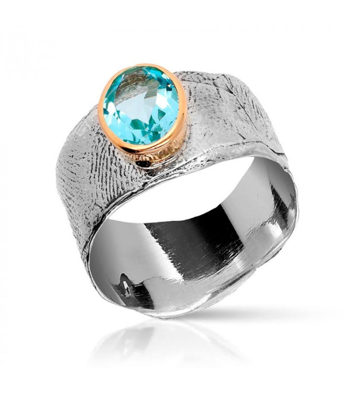 Wax ring with gold and topaz surround