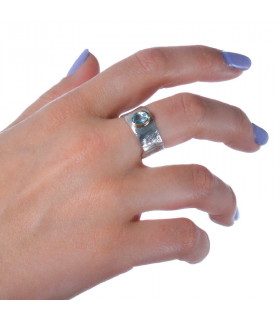 Precious wax ring with blue stone